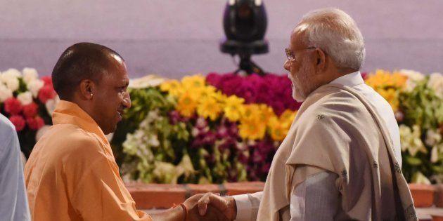 Prime Minister Narendra Modi and Uttar Pradesh Chief Minister Yogi Adityanath greets each other at an...