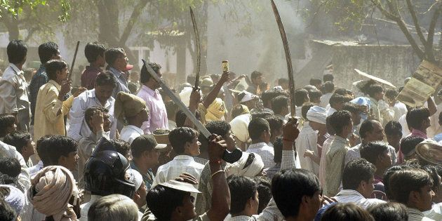 A 2002 photo of a Hindu mob waving swords during communal riots in