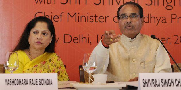 Former Madhya Pradesh Commerce Minister Yashodhara Raje Scindia with Madhya Pradesh Chief Minister Shivraj...