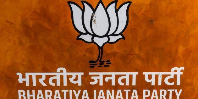 An empty chair is kept against the banner of Bharatiya Janata Party (BJP) at the party headquarters in...