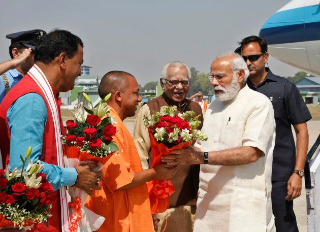 Indian Prime Minister Narendra Modi, right, is received by Uttar Pradesh Chief Minister Yogi Adityanath,...