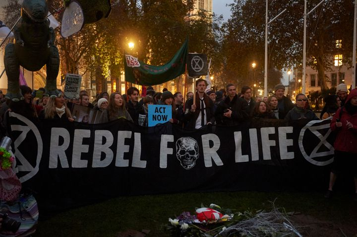 Environmental activists gather in Parliament Square, London, the U.K., during a demonstration organised by the movement Extin
