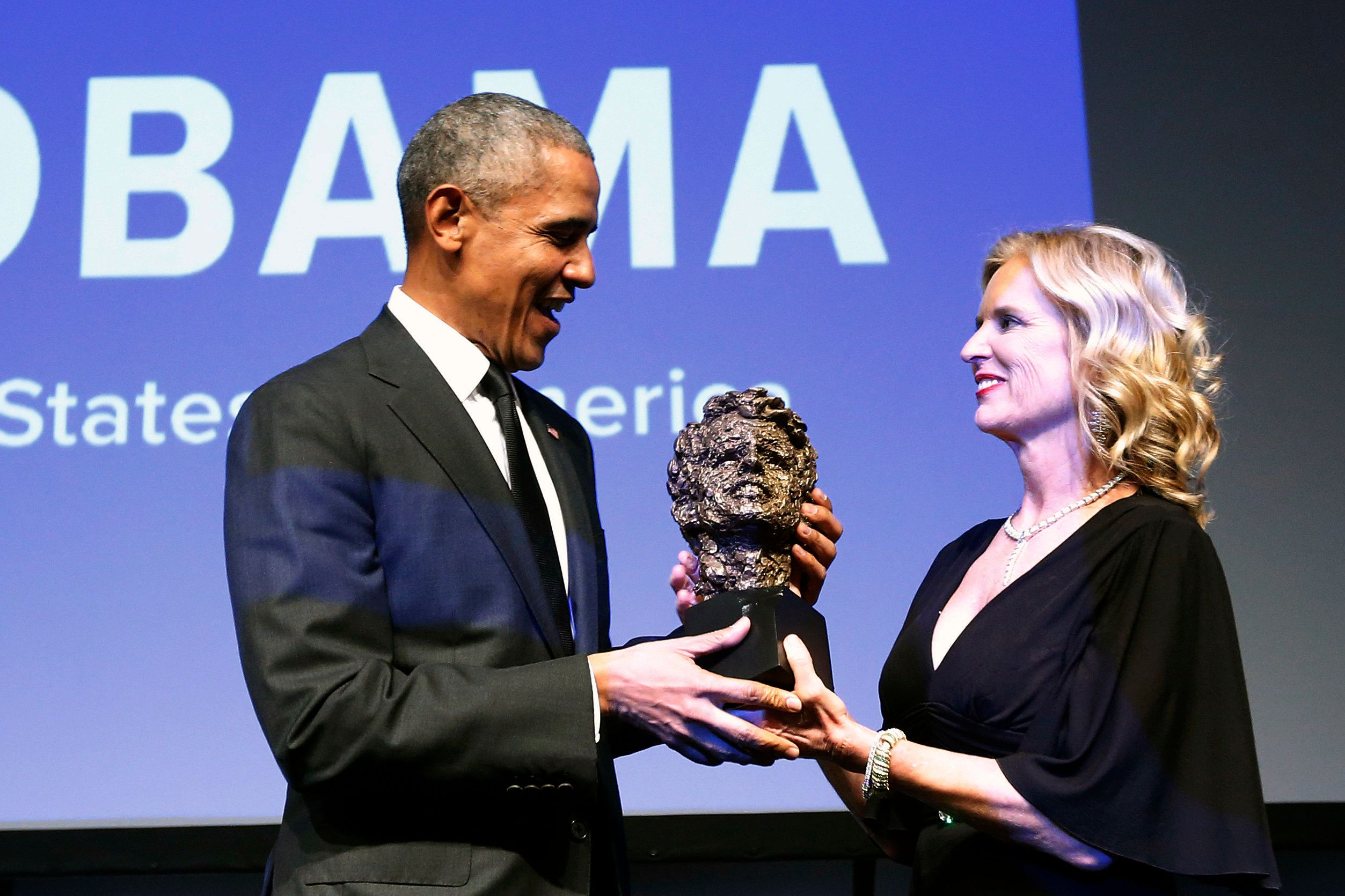 Robert F. Kennedy Human Rights President Kerry Kennedy presents former President Barack Obama with the foundation's Ripple of Hope Award at a ceremony, Wednesday, Dec. 12, 2018, in New York. (AP Photo/Jason DeCrow)