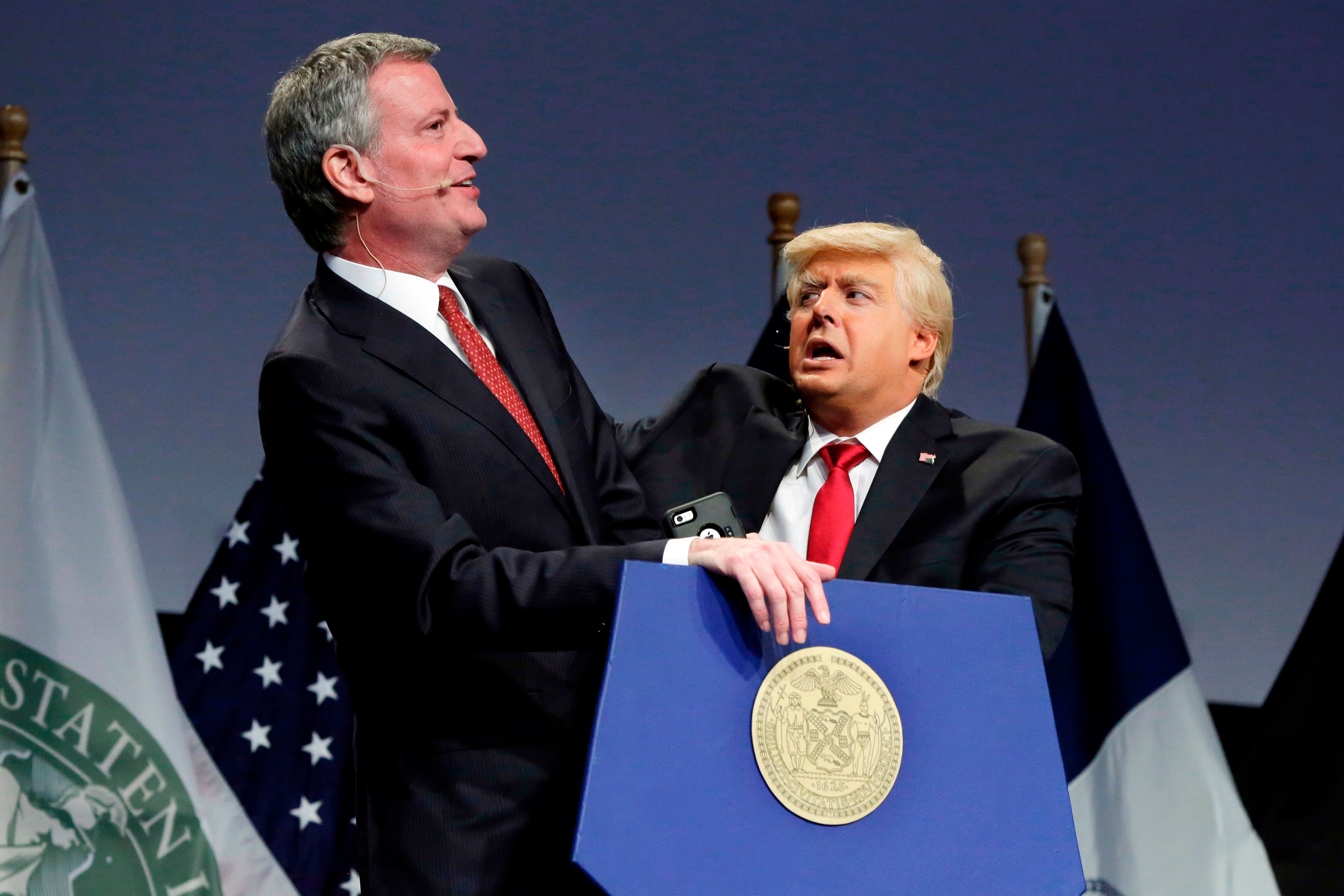 """New York Mayor Bill de Blasio, left, performs with Donald Trump impersonator Anthony Atamanuik, during the mayor's response to """"Curb Your Narcissism,"""" the 95th annual Inner Circle Show, in New York, Saturday, April 21, 2018. The charity event features New York City's political reporters who spoof the president, the mayor, and politicians. (AP Photo/Richard Drew)"""