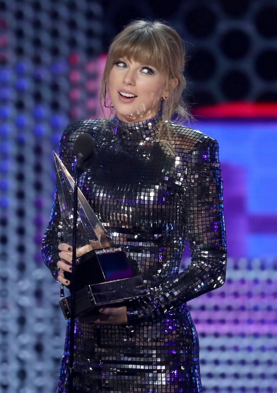 Taylor Swift accepts an award at the American Music Awards.