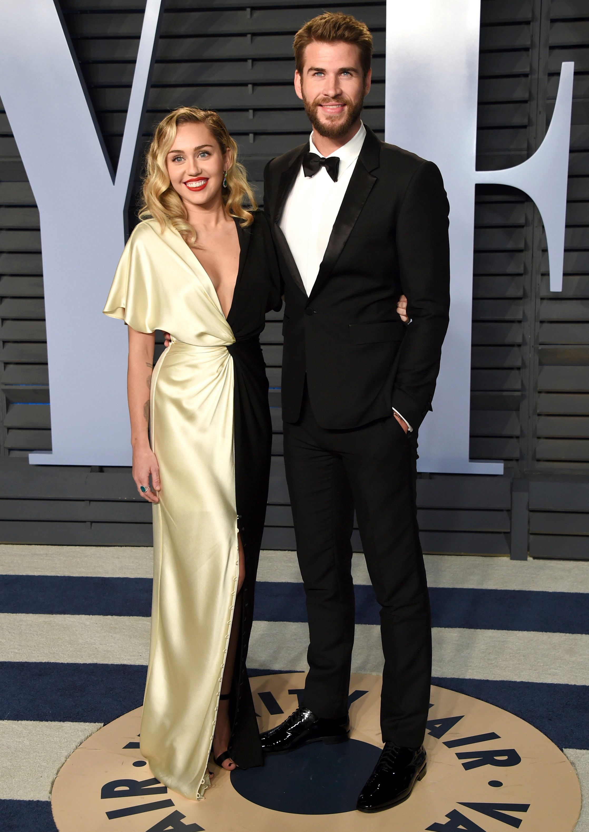 Miley Cyrus and Liam Hemsworth arrive at the Vanity Fair Oscar Party on March 4.