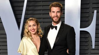Miley Cyrus, left, and Liam Hemsworth arrive at the Vanity Fair Oscar Party on Sunday, March 4, 2018, in Beverly Hills, Calif. (Photo by Evan Agostini/Invision/AP)