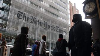 NEW YORK, NY - NOVEMBER 21: People walk past the front of the New York Times building on November 21, 2018  in New York City. (Photo by Gary Hershorn/Getty Images)