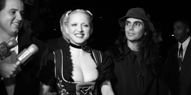 Madonna and photographer Steven Meisel arrive at a New York party for