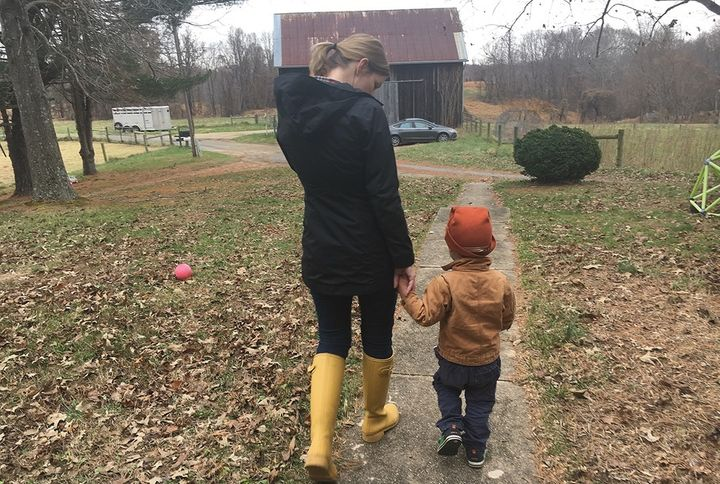 Jamie Tiralla, 36, walks with her 3-year-old son, Isaac, on the family's farm in Prince Frederick, Maryland. Tiralla and her