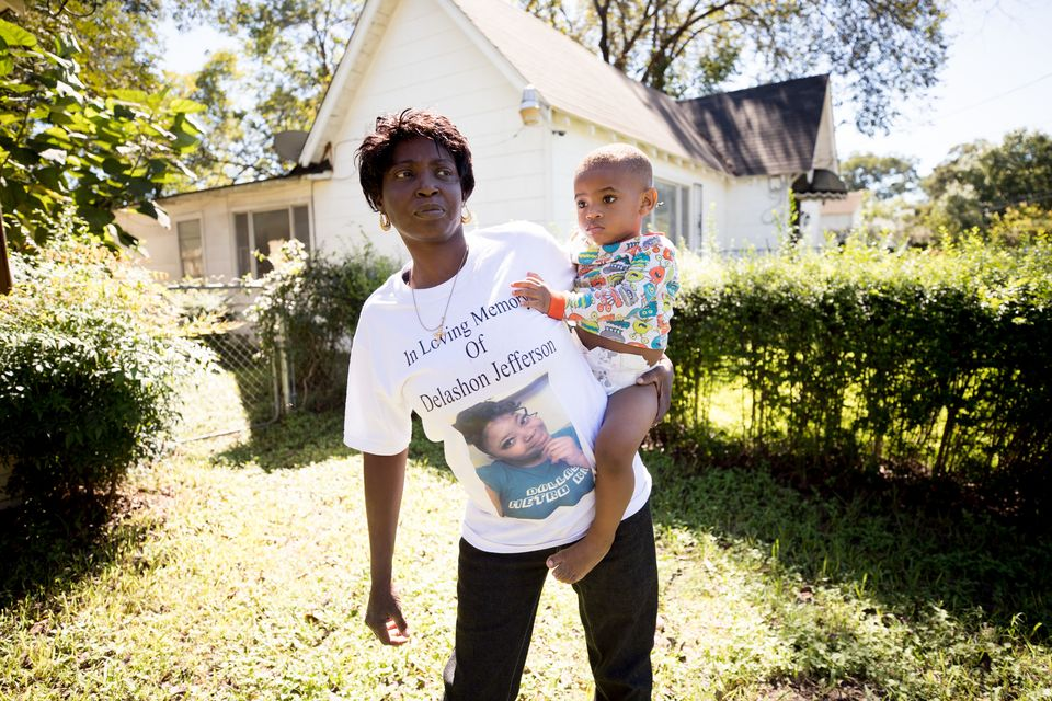 Sharon Jefferson holds her grandson, Rayray. Police say her pregnant daughter, Delashon, was fatally...