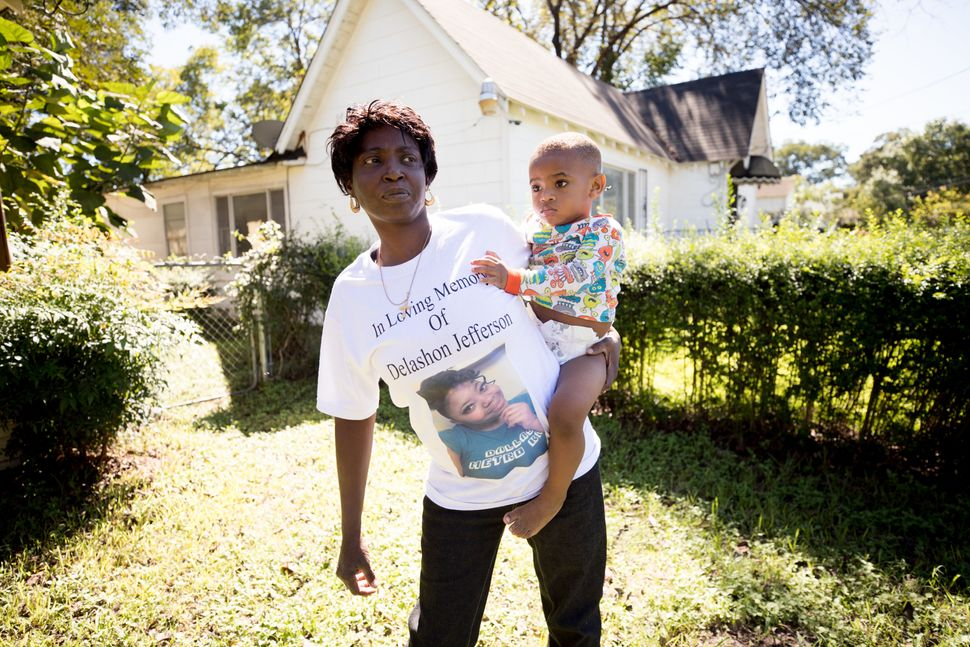 Sharon Jefferson holds her grandson, Rayray. Police say her pregnant daughter, Delashon, was fatally shot by her boyfriend in