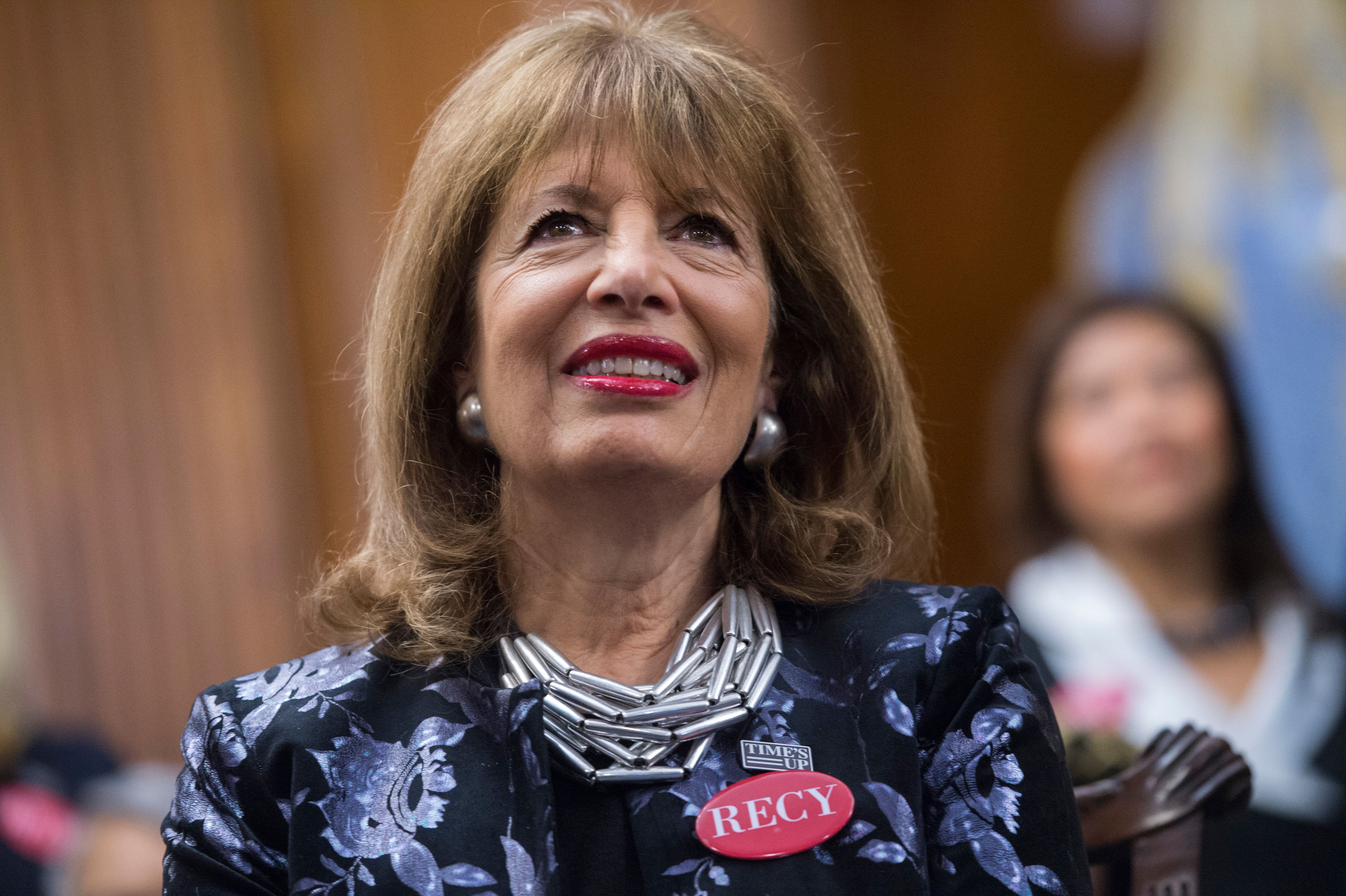 UNITED STATES - JANUARY 30: Rep. Jackie Speier, D-Calif., wears a pin featuring the name of sexual assault survivor Recy Taylor, during a photo op in the Capitol's Rayburn Room to show solidarity with men and women who are speaking out against sexual harassment and discrimination on January 30, 2018. (Photo By Tom Williams/CQ Roll Call)