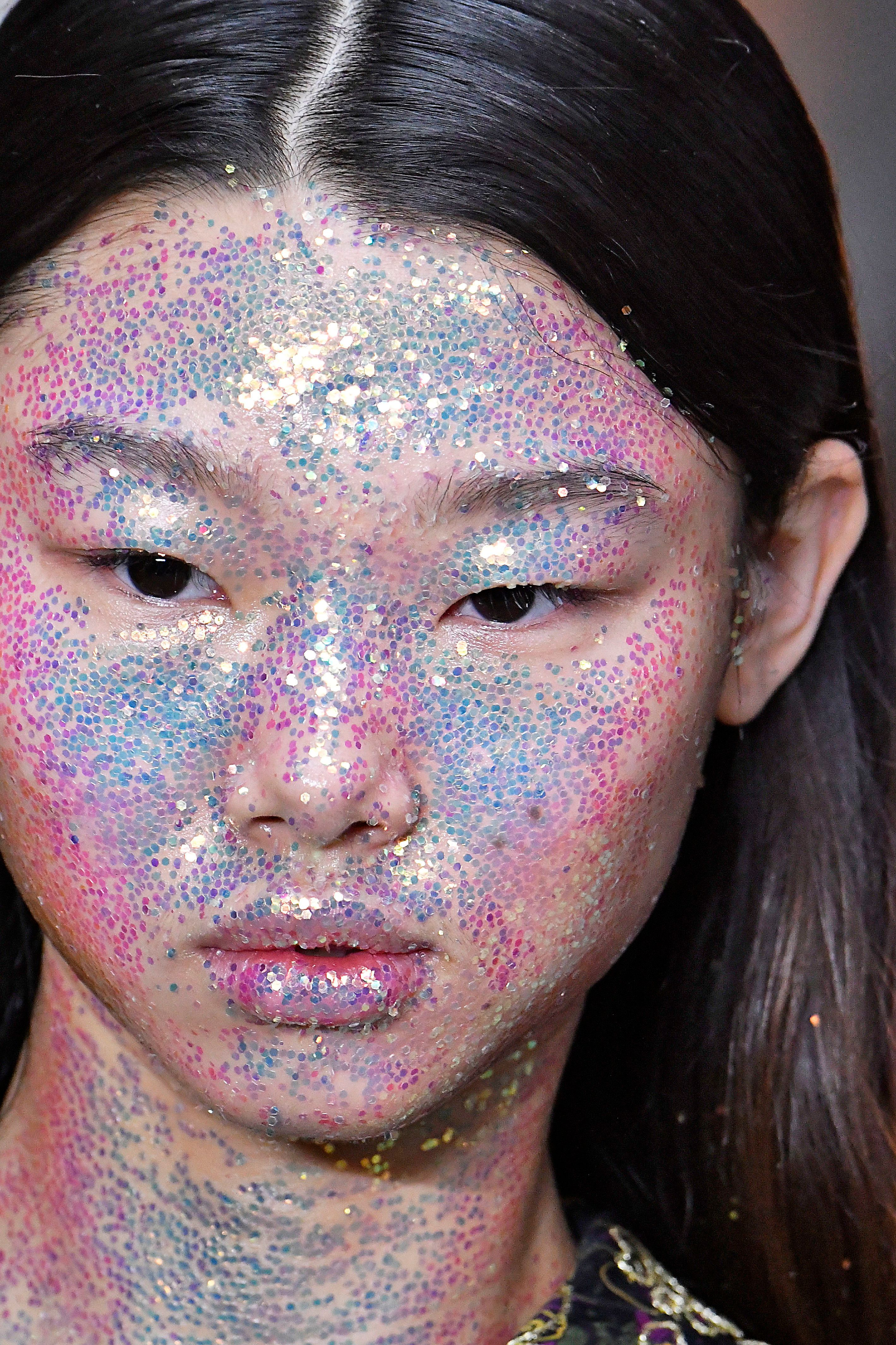 A model with a face covered in glitter at the Giambattista fall 2018 ready-to-wear show in Paris.If you don't want to look like a disco ball, this is probably a look you should avoid.