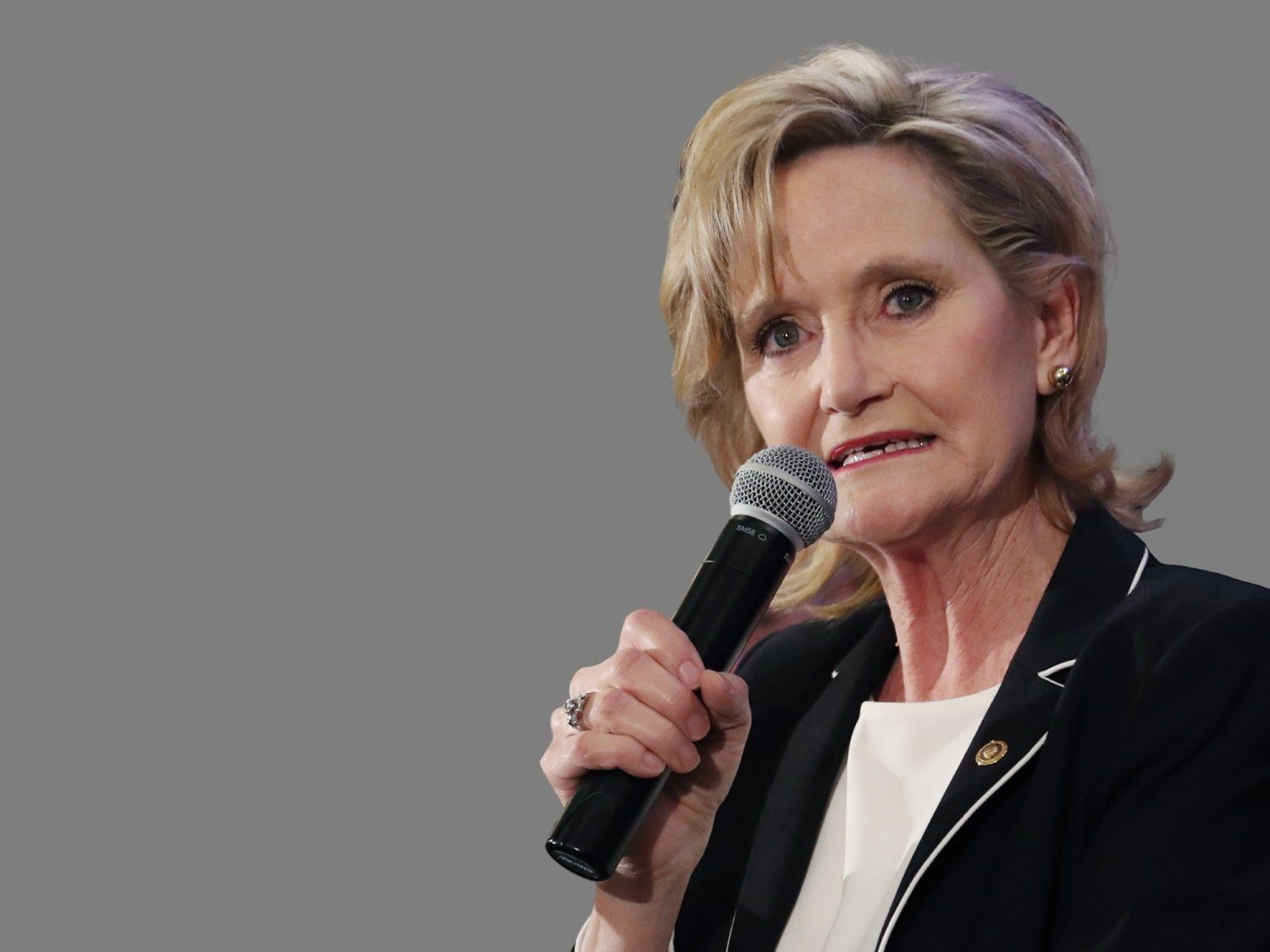 Cindy Hyde-Smith, Republican US Senator, speaks to supporters as she celebrates her runoff win over Democrat Mike Espy in Jackson, Mississippi, graphic element on gray