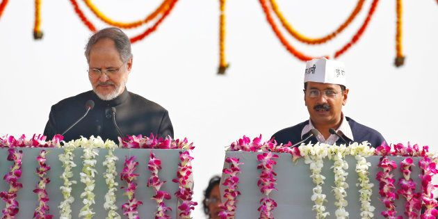 Najeeb Jung (L), Delhi's Lieutenant Governor, administers the oath to Arvind Kejriwal as the new chief...
