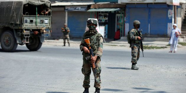 Indian army soldiers stand guard on a street on the outskirts of Srinagar, India, September 21, 2016....
