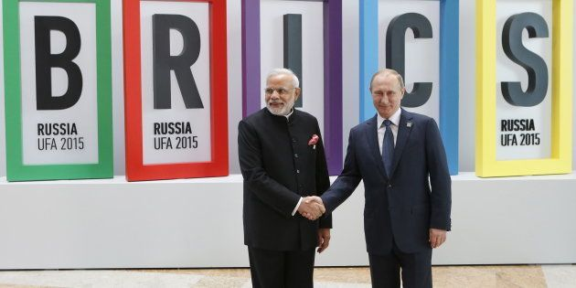 Russian President Vladimir Putin (R) greets Indian Prime Minister Narendra Modi during the welcoming...