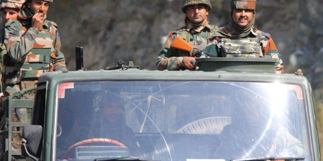 A convoy of Indian troopers passing through the border line area in Uri sector, which is approximately...