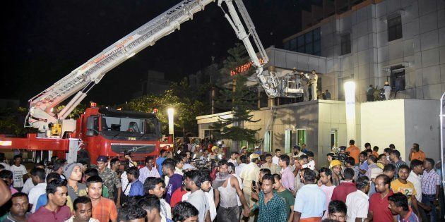 This photograph taken on October 17, shows Indian rescue workers trying help victims of a massive fire...