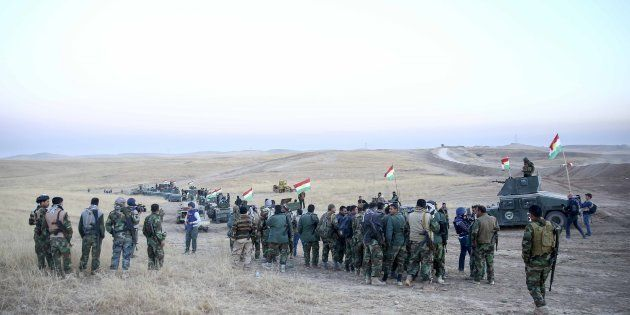 Peshmerga forces stand guard at Hazer region's Wardak village during an operation to retake Iraq's Mosul...