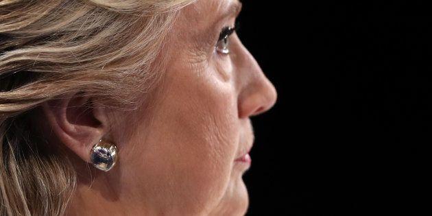 Democratic U.S. presidential nominee Hillary Clinton listens as Republican U.S. presidential nominee...