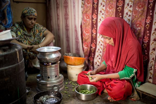 Ayesha in her home in Kolkata helps her mother with the chores of the house.