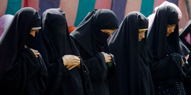 Kashmir Muslim women offer prayers during Eid al-Fitr in Srinagar September 11,
