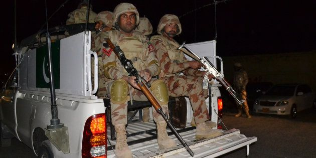 Pakistani troops enter in the police training school attacked by militants in Quetta, Pakistan, Tuesday,...