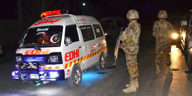 An ambulance carries injured officers to a hospital outside a police training school attacked by militants...
