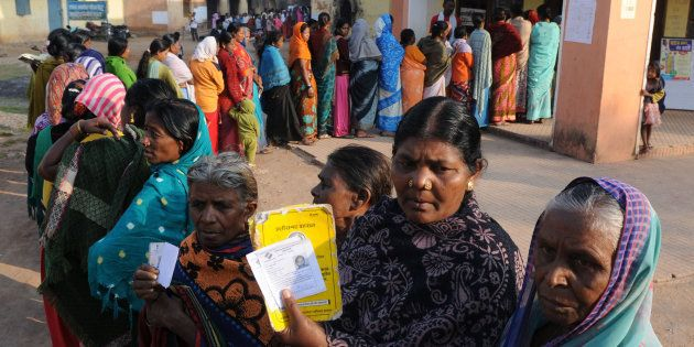 Voters showing their ID cards at a polling booth during the first phase of assembly elections of Chhattisgarh...