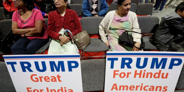 Signs placed on seats as people wait for a charity event hosted by the Republican Hindu