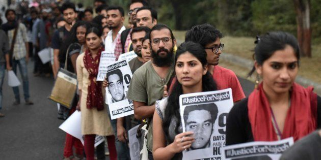 Members of JNUSU during a protest regarding the missing case of JNU student Najeeb Ahmad. (Photo by Ravi...