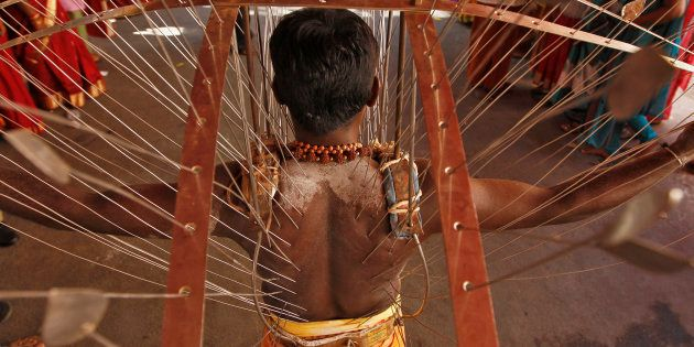 [File photo] A Hindu devotee, whose body is pierced with skewers, takes part in the religious festival...