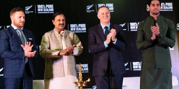 New Zealand cricketer Brendon McCullum (L), India Tourism and Cultural Minister Mahesh Sharma (2L) watches...
