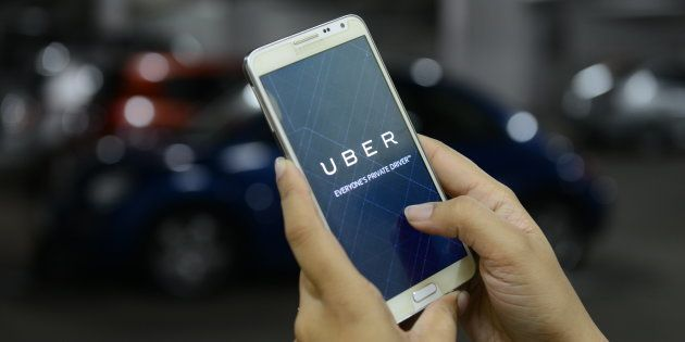 A passenger booking an Uber cab using the mobile app on 1 October 2015 in Bengaluru. (Photo by Hemant...