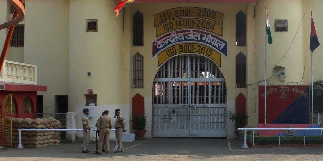 Indian police officials gather at the entrance to The Central Jail in Bhopal on November 1, 2016, a day...