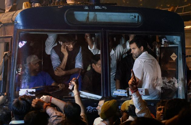 New Delhi: Congress party Vice President Rahul Gandhi being carried in a police bus from Parliament Street...