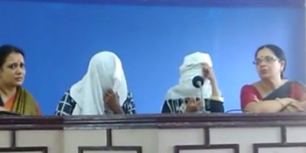 The gang rape survivor addresses a press conference along with her husband. Their faces have been covered...