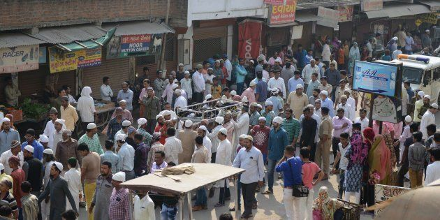 Indian Muslims participate in a funeral procession for Mujib Shaikh, an alleged Islamic militant linked...