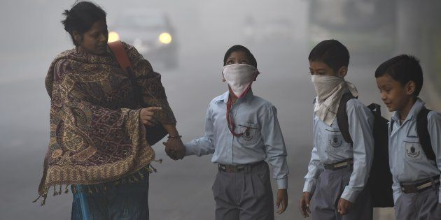 School children taking precautions as city covered under a blanket of heavy smog, air quality deteriorated...