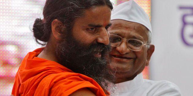 File photo of Indian yoga teacher Swami Ramdev (L) with veteran social activist Anna