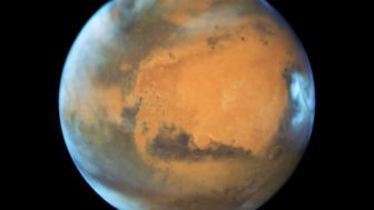 The planet Mars is shown May 12, 2016 in this NASA Hubble Space Telescope view taken May 12, 2016 when it was 50 million miles from Earth. Earth's neighbor planet makes its closest approach in a decade this month, providing sky-watchers with a celestial show from dusk to dawn.    NASA/Handout via Reuters   ATTENTION EDITORS - THIS IMAGE WAS PROVIDED BY A THIRD PARTY. EDITORIAL USE ONLY