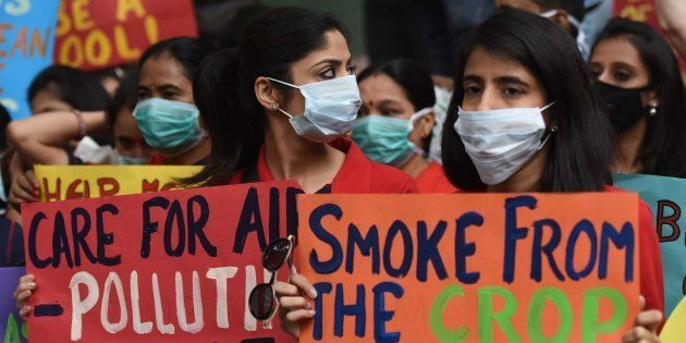 People wear pollution masks during the protest march for 'Your Right To Breathe' at Jantar Mantar, on...