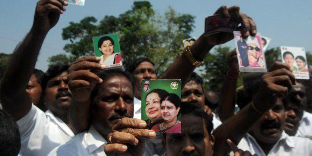 Members of the All India Anna Dravida Munnetra Kazhagam (AIADMK) party display portraits of VK Sasikala...