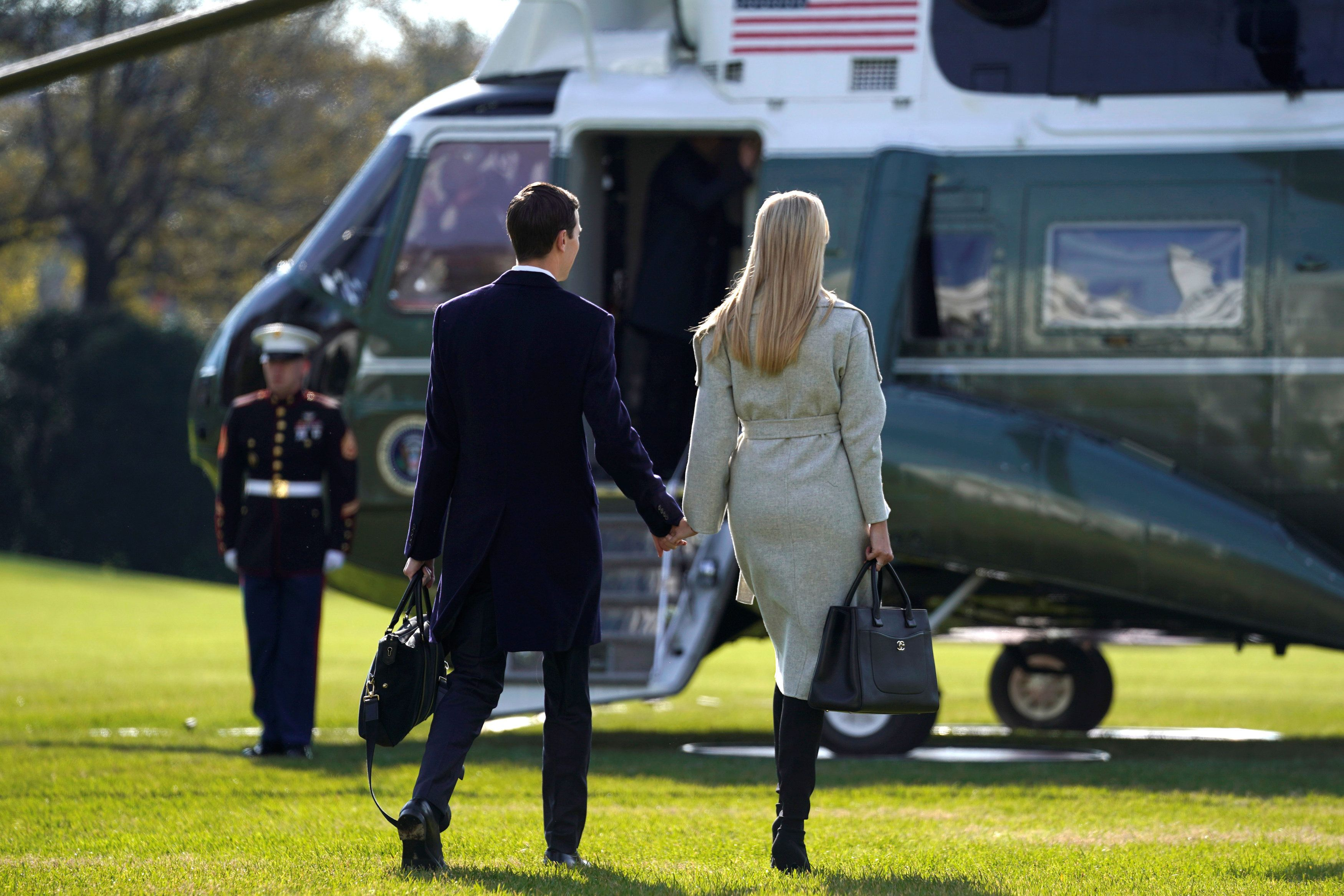 White House senior advisor Jared Kushner and his wife, fellow White House senior advisor Ivanka Trump, walk out to the Marine One helicopter to depart with U.S. President Donald Trump for travel to the G-20 summit in Argentina from the White House in Washington, U.S., November 29, 2018. REUTERS/Jonathan Ernst