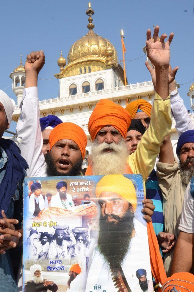 Indian Sikh activists from radical Sikh organisations shout slogans in support of Sikh leader Sant Jarnail...