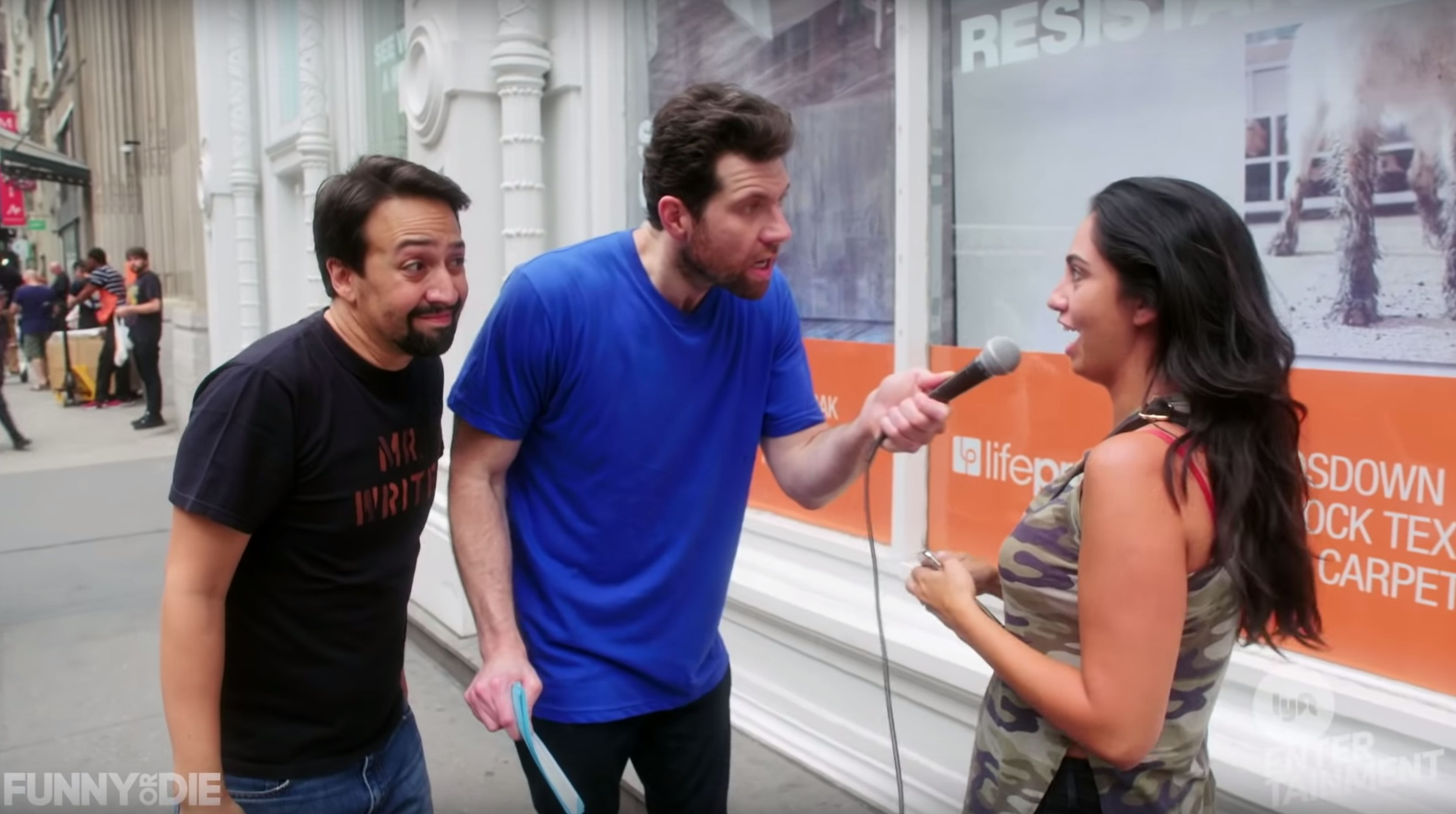 Billy Eichner and Lin-Manuel Miranda walk around the streets of NYC asking people if they're happy.