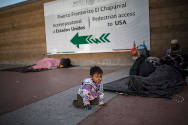 Steven Aguila, 2, from El Salvador, plays with a toy car at El Chaparral border crossing in Tijuana, Mexico, on Nov. 23.