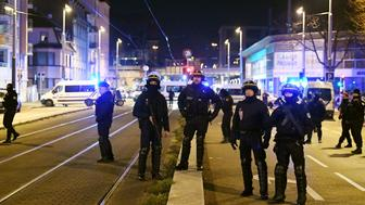 french police officers block the road near the site where cherif chekatt the alleged gunman